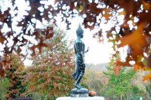 The walking Buddha statue in front of the meditation hall at the Mid-America Buddhist Association